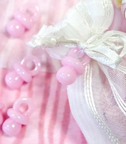 Confettis de table tétine rose